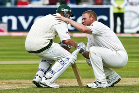Andrew Flintoff (right) of England consoles Brett Lee (left) of Australia after England won the second Ashes Test Match by two runs at the Edgbaston cricket ground in August 2005.