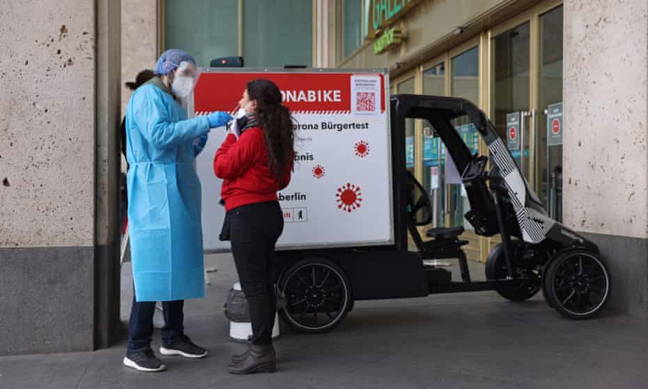 A woman in Berlin takes a test at a mobile coronabike