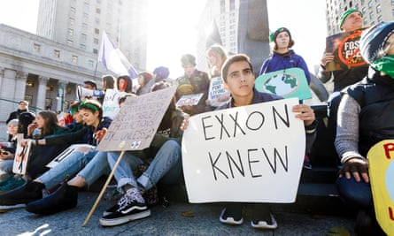 A group of climate activists rally across from a courthouse where ExxonMobile was sued by the New York attorney general, November 2019.