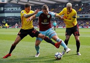 Watford's Etienne Capoue and Jose Holebas get to grips with Burnley's Sam Vokes asBurnley win 2-1 away at Vicarage Road.