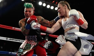 Heather Hardy and Shelly Vincent exchange blows during their women's featherweight title fight at Madison Square Garden in October
