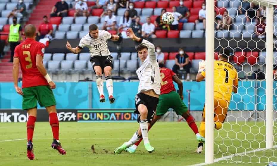 Robin Gosens thumps a header past Portugal goalkeeper Rui Patrício.