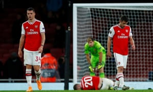 Granit Xhaka, on his return to the Arsenal side after a five-game absence, cuts a dejected figure after Eintracht Frankfurt's Daichi Kamada scores their second goal.