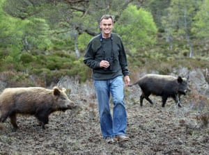 Paul Lister with wild boar introduced on to his estate in Sutherland, Scotland.
