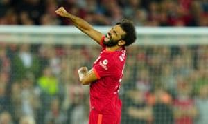 Mohamed Salah of Liverpool celebrates scoring a goal after making it 2-2 after a VAR check.