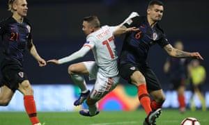 Dejan Lovren challenges for the ball during Croatia's win over Spain.