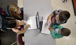children using laptops