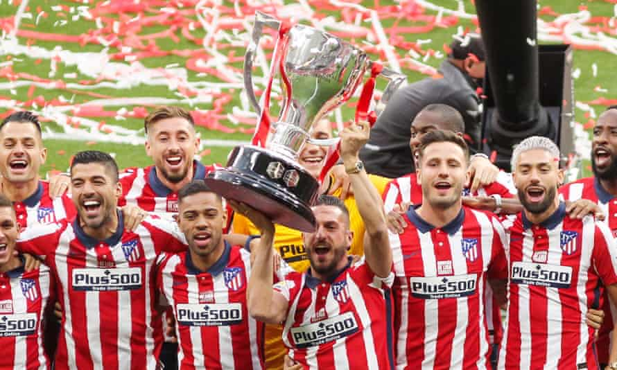 Atlético Madrid players celebrate winning the La Liga match Champions Trophy.