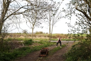 Melissa Wilson, who hopes to make Great Britain's rowing team at next year's Tokyo Olympics, performs a homemade circuits session in a forest near her house in Gloucester.