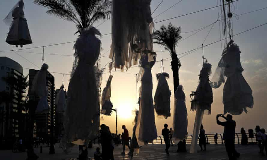 Wedding dresses displayed in Beirut as a protest against a similar law shielding rapists from prosecution.