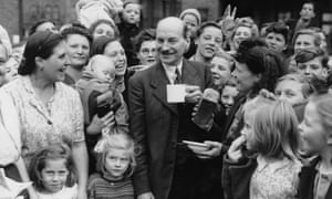 Clement Attlee chatting to campaigning in his Limehouse constituency on 5th July 1945 on his way to a landslide victory in the general election.
