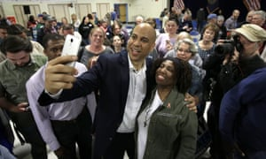 Cory Booker takes selfies with residents in Londonderry, New Hampshire.