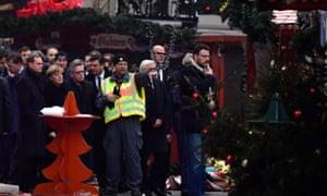 German Chancellor Angela Merkel and Berlin's mayor Michael Mueller visit the terror attack scene at the Christmas market near the Kaiser-Wilhelm-Gedaechtniskirche