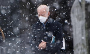 US President Joe Biden makes his way to his vehicle in the snow, after attending Mass at Saint Joseph on the Brandywine Church in Wilmington, Delaware on 7 February 2021.