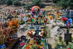 Valle de Chalco, Mexico – Graves are decorated in preparation for the Day of the Dead