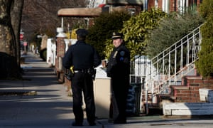 Police officers stand outside a home in Brooklyn on Monday. Public records showed that an A Ullah had been registered at an address in Kensington.