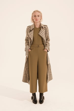 khaki coloured jumpsuit, check patterned coat, cream, beige black, black high heeled boots with large metal ring on the front