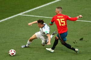 Golovin goes down under pressure from Ramos.