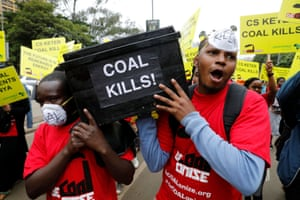 Environmental activists carry a coffin during a protest in Nairobi, Kenya