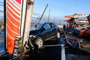 Workers look over damage in the Germantown area.