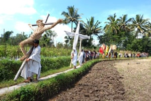 Christians carry crosses during a procession at Magelang in Java, Indonesia