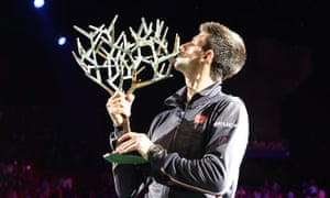 Novak Djokovic poses with the trophy after winning the tournament in 2014.
