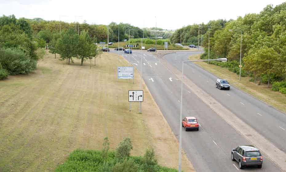 Cars approach a roundabout