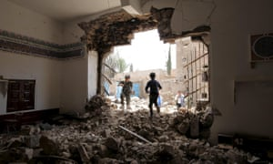 People enter a damaged mosque from a hole in its wall, at the site of a car bomb attack in Yemen's capital Sana'a