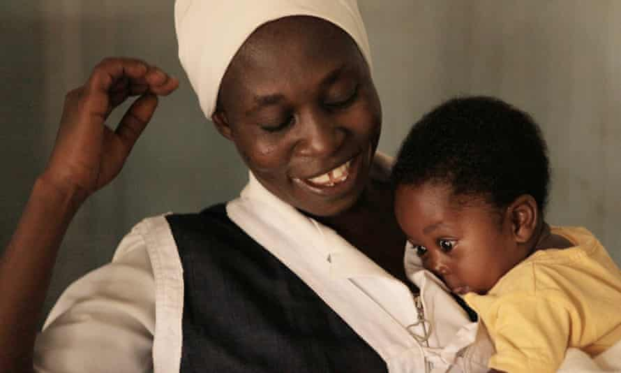 Midwife with baby in northen Nigeria