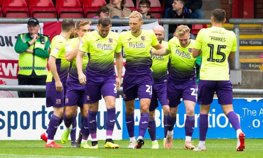 Exeter's players celebrate a goal against Crewe earlier this month
