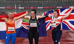 Medalists Noelle Roorda of the Netherlands (left), Holly Robinson of New Zealand (centre) and Hollie Arnold of Britain celebrate after the javelin event.