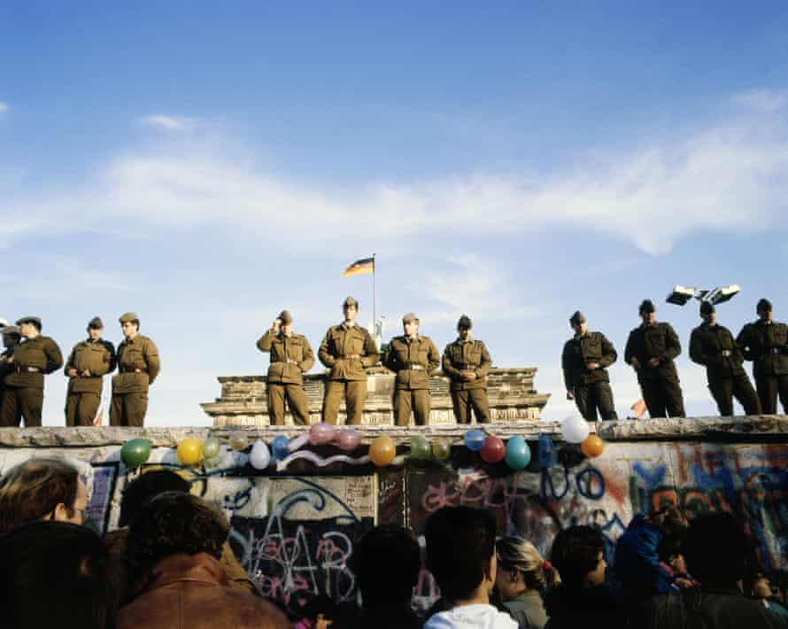 East Germans gather in front of the Berlin Wall in 1989