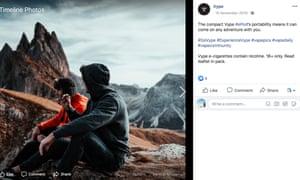 Two men hiking and having a e-cigarette break