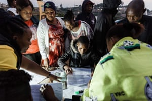 People arrive early to check their names before voting in Cottanlands, north of Durban