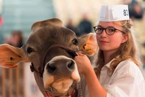 Cournon-d'Auvergne, FranceA milkmaid poses with a French breed Brune cow (French Brown), during the third day of the 'Sommet de lÉlevage 2018' Trade Fair in Cournon-d'Auvergne, near Clermont Ferrand in central France. - The three day Sommet de lÉlevage 2018 Trade Fair, is a showcase highlighting French breeders, and includes competitions, technical innovations, professional events, practical demonstrations and conferences dealing with agricultural current affairs.