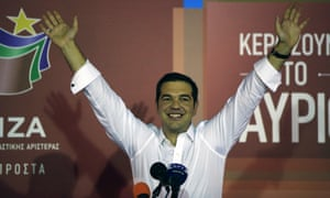 Alexis Tsipras the leader of left-wing Syriza party waves to his supporters after the election results at the party''s electoral base in Athens tonight.