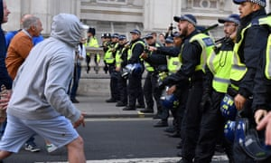 Protesters confront police near the houses of parliament on 7 September.