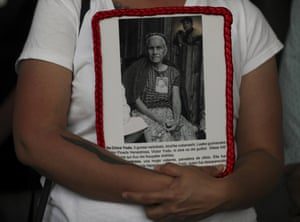 Mexico City, Mexico. A person holds a portrait of a missing woman during a protest outside of the general prosecutor's office. The government says that more than 80,000 people have disappeared in Mexico since the country's drug war began in 2006