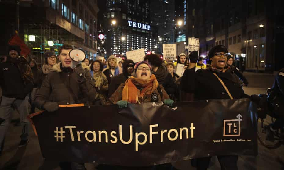 Demonstrators protest for transgender rights in Chicago after President Donald Trump's recent decision to reverse the Obama-era policy requiring public schools to allow transgender students to use the bathroom that corresponds with their gender identity.