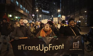 Demonstrators protest for transgender rights with a rally in Chicago.