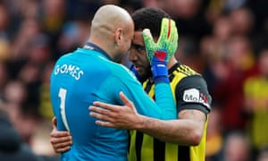 Watford's Heurelho Gomes is embraced by Troy Deeney as he cries at the end of the match.