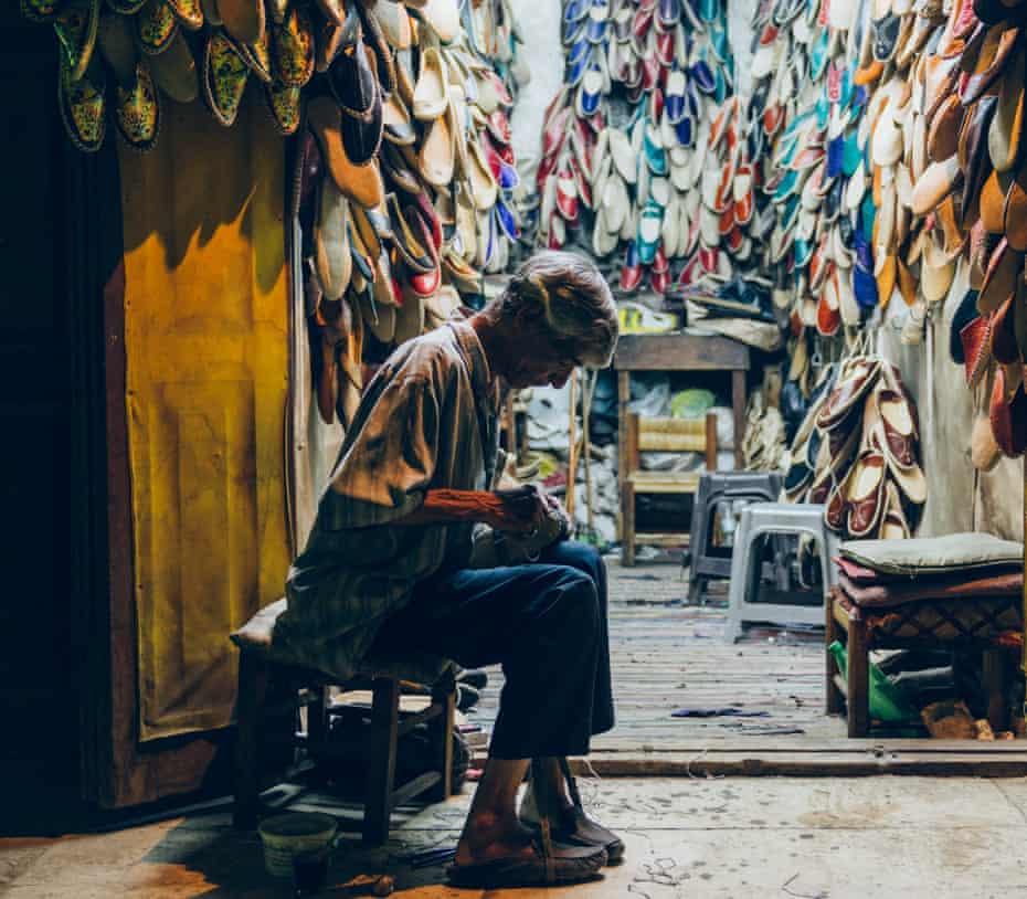 A cordwainer (shoe-maker) in the markets of al-Darb al-Ahmar