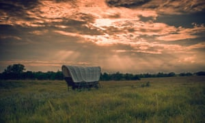 A lone covered wagon on the prairie at Rock Creek state park, Nebraska.