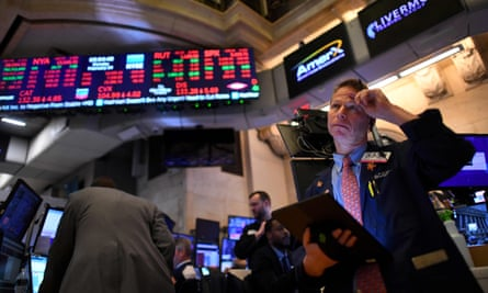 Traders work during the closing bell at the New York Stock Exchange on Monday in New York City.