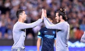 Cristiano Ronaldo and Gareth Bale celebrate scoring against Manchester City in an easy pre-season win.