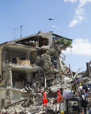 Rescue workers search the rubble.