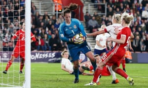 Laura O'Sullivan, who works full-time as an office administrator makes a save during Wales' 0-0 draw with England in April.