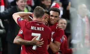 James Milner and Trent Alexander-Arnold celebrate with Roberto Firmino after his dramatic late winner.