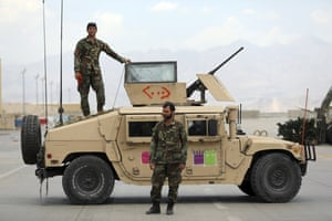Afghan troops with an armoured vehicle.