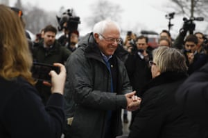 Bernie Sanders meets with people outside a polling place in Manchester, N.H.